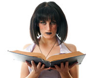 Gothic woman holding a book Royalty Free Stock Images