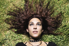 Gothic woman lying in grass Stock Images