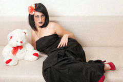 Gothic woman lying on the sofa Stock Photography