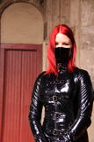 Gothic woman pvc jacket and facemask stock image