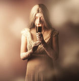Gothic woman slipping wine glass. Halloween party Royalty Free Stock Photography