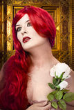 Gothic woman with white rose in her hand Royalty Free Stock Images