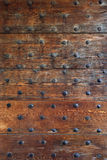 Gothic wood door. Background of an old gothic door from a historic church Stock Photo