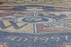 Gothic Wroclaw Old Town Hall on market square, mosaic from cobblestones, arms, Wroclaw, poland. Gothic Wroclaw Old Town Hall on market square, colorful  mosaic Stock Photos