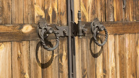 Gothic wrought iron elements on the wooden plank gate. Gothic wrought iron elements on the yelow wooden plank gate Royalty Free Stock Photography