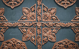 Gothic wrought-iron ornament. Vintage armored fortress door Stock Photos