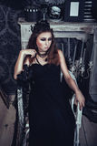 Gothic young girl in elegant black dress Stock Photography