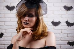 Gothic young woman with dark makeup. Halloween, celebration, par stock photography
