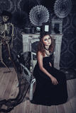 Gothic young woman in an elegant black dress Stock Photography