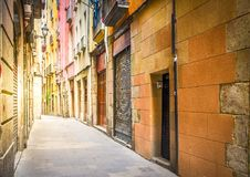 Gotic quarter of Barcelona. Narrow street in Barrio Gotic quarter of Barcelona, Spain, toned stock images