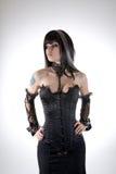 Gotisk flicka i svartkorsett arkivbild