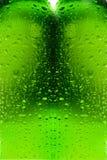 Gotitas de agua en la botella de cristal Imagen de archivo libre de regalías