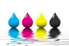 Gotitas del color de CMYK Foto de archivo libre de regalías