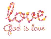 Gott ist Liebesblumenbeschriftung Lizenzfreie Stockbilder