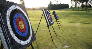 Gotta Reach the Target. Target boards at an archery range. Can be use as a metaphors in sales/ marketing about reaching sales target, etc Stock Photo