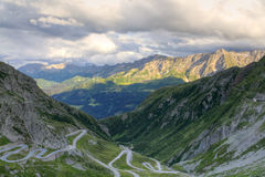 Gotthard mountain pass, Switzerland. Old road with tight serpentines on the southern side of the St. Gotthard pass bridging swiss alps at sunset in Switzerland Royalty Free Stock Photography