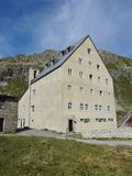 Gotthard, Switzerland. Hospice at the mountain pass. Summer time Royalty Free Stock Images