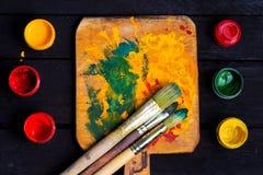 Gouache con los cepillos Imagen de archivo libre de regalías