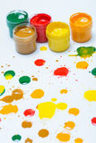 Gouache in jars and drops Royalty Free Stock Photo