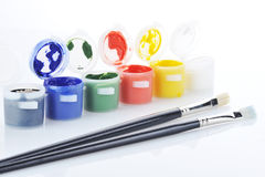Gouache paint and brush stock photos