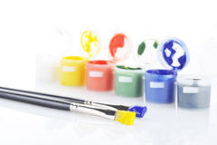 Gouache paint and brush royalty free stock image