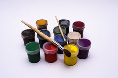 Gouache paint and brush. Jars with paints and brushes to paint prepared royalty free stock photos