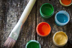 Gouache paint brush for painting on an old wooden Royalty Free Stock Photography