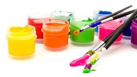 Gouache paint brush  on a white Stock Photo