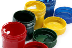 Gouache paint cans. On white background Stock Images