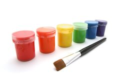 Gouache paint cans and brush Royalty Free Stock Image