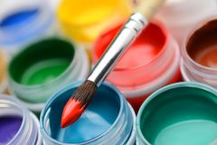 Gouache paint jars and paintbrush Stock Photo