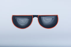 Gouache painted illustration. Funny paper sunglasses on white background Stock Images