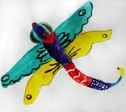 Fairytale dragonfly painted by child. Gouache painting of a colorful fairy tale dragonfly made by child royalty free illustration