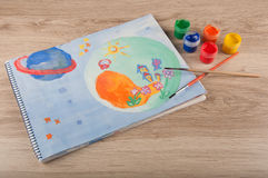 Gouache painting of space drawn on paper lay on table Royalty Free Stock Photos