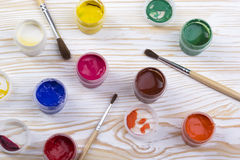 Gouache paints and brushes on wooden backgound Stock Images