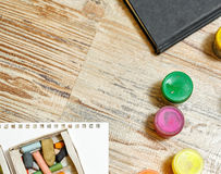 Gouache paints and pastel crayons close-up. Stock Photo