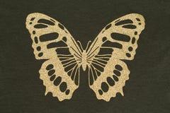 Goud applique in de vorm van een vlinder stock fotografie