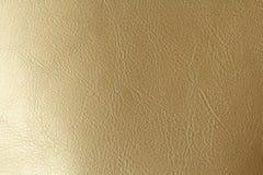 Goud of Brons Natuurlijke Leerachtergrond Glanzende gele de textuurachtergrond van de blad gouden folie Plaats voor tekst stock fotografie