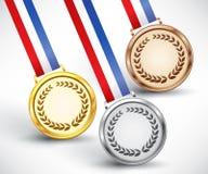 Goud, zilver en bronstoekenningsmedailles Stock Foto's