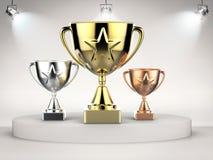 Goud, zilver en bronstrofee op stadium Royalty-vrije Stock Afbeelding
