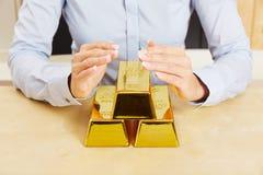 Goud zoals veilige investering stock fotografie