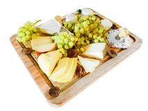 Various Cheeses, Grapes, and Figs, on a Cutting Board. Gouda cheese, Brie, Wensleydale cheese with cranberries, and other cheeses, with green grapes, and figs Royalty Free Stock Photo