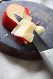 Gouda cheese slice from wedge Stock Photography