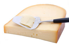 Gouda cheese with slicer Royalty Free Stock Photography