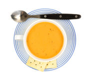 Gouda cheese soup in coffee cup with spoon Stock Images