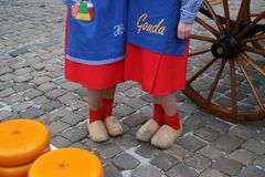 Gouda - Netherlands - april 5th 2018 - start of the touristic cheese market with children and old farmers and cheesemakers to demo. Ntrate cheese selling from Royalty Free Stock Photo