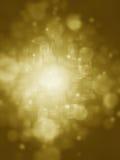 Gouden abstracte achtergrond met bokehlichten en sterren Stock Afbeelding