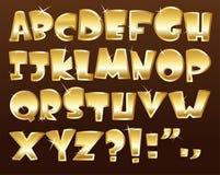 Gouden alfabet Stock Foto