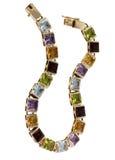 Gouden armbanden en edelstenen royalty-vrije stock foto