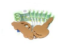 Gouden autosleutel en geld Royalty-vrije Stock Foto